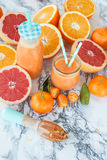 Juice made from fresh citrus fruits Stock Photography