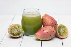 Juice made from opuntia ficus-indica cactus fruits on a white ba Stock Photography
