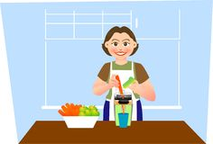 Juice maker. A lovely mother is making carrot juice in kitchen Stock Image