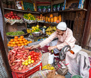 Juice maker in Indian fruit shop stock photos