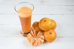 Juice of mandarins. fresh juice. citrus tangerines. natural juice royalty free stock photo