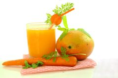Juice of mango and carrot. Mango and carrot juice with mango carrot and herbs Stock Image