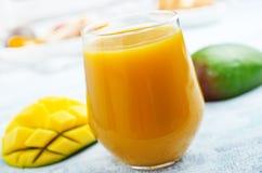 Juice. Mango juice in glass, fresh juice and fruits royalty free stock photos