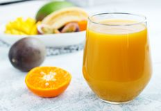Juice. Mango juice in glass, fresh juice and fruits royalty free stock images