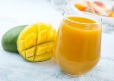 Juice. Mango juice in glass, fresh juice and fruits stock photos