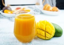 Juice. Mango juice in glass, fresh juice and fruits stock photography