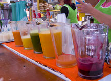 Juice Market. A small fruit juice stand inside a farmers market in a rural area of Mexico Stock Photo