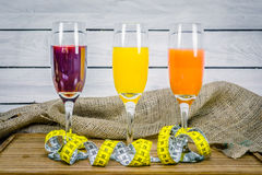 Juice with measure tape wooden table Royalty Free Stock Photo