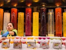 Juice merchant in Barcelona market Stock Photo