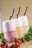 Juice and milk tea. Ice milk tea and strawberry milk tea Royalty Free Stock Images