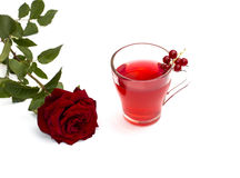 Juice mug, scarlet rose and currant Royalty Free Stock Photo