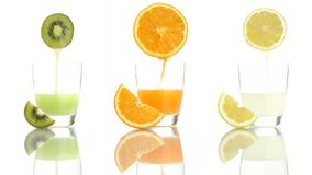 Juice orange lemon kiwi poured into glass stock video footage