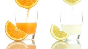 Juice orange lemon poured into glass. On white background stock video footage
