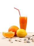 Juice orange lemon shells on sand. Stock Image