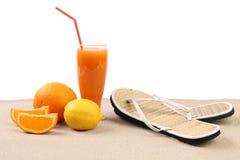 Juice orange lime sandals on sand. White background royalty free stock image