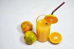 Orange Juice, 100% Fruit Juice, Beneficial to the Body, Drink to nourish and Health Care. Juice - 100% orange juice, served in clear glass. Decorated with Royalty Free Stock Photo
