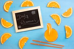Juice and orange slices as daily vitamins Royalty Free Stock Images