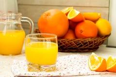 Juice and oranges Stock Photos