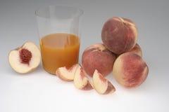 Juice organic peach on a white background Stock Photos