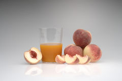 Juice organic peach on a white background Royalty Free Stock Image