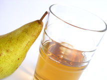 Juice and pear Royalty Free Stock Photos