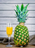 Juice from a pineapple Stock Photos