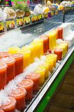 juice plastic cups in different colors. Royalty Free Stock Image