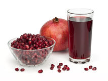 Juice and pomegranate fruits Stock Photo