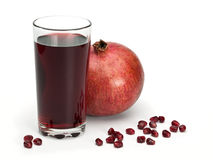 Juice and pomegranate fruits Royalty Free Stock Image