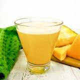 Juice pumpkin on light board Royalty Free Stock Image