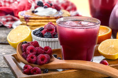 Juice of raspberries and blackberries stock photography