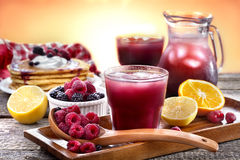 Juice of raspberries and blackberries Stock Image