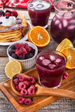 Juice of raspberries and blackberries royalty free stock images