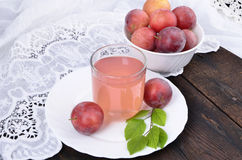 Juice of red plums Stock Photo