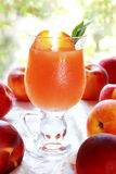 Juice from ripe fruits of a peach Royalty Free Stock Photo