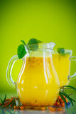 Juice from ripe sea-buckthorn berries Stock Photos