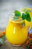 Juice from ripe sea-buckthorn berries Royalty Free Stock Image