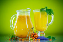 Juice from ripe sea-buckthorn berries Royalty Free Stock Photos
