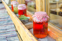 Juice of roses in a jars. Red juice of roses in a jars Stock Image