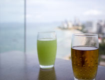 Juice with seaview. Apple juice and guava juice with seaview royalty free stock photo
