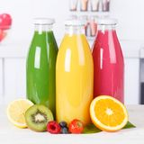 Juice smoothie orange smoothies in kitchen bottle square fruit f stock photos