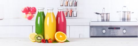 Juice smoothie orange smoothies in kitchen copyspace banner bottle fruit fruits. Juice smoothie orange smoothies in kitchen copyspace banner copy space bottle stock photos