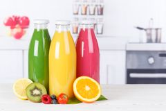 Juice smoothie orange smoothies in kitchen copyspace bottle fruit fruits. Juice smoothie orange smoothies in kitchen copyspace copy space bottle fruit fruits stock photography