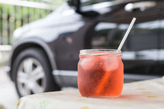 Juice soda. Ice glass with Plastic Drinking Straw Royalty Free Stock Image