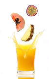 Juice splash with tropical fruits Royalty Free Stock Image