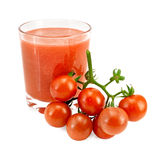 Juice tomato in a glass and a bunch of tomatoes Stock Photos