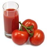 Juice and tomato  Royalty Free Stock Photo