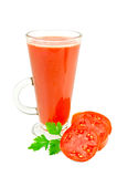 Juice tomato in a tall glass with parsley Royalty Free Stock Photo