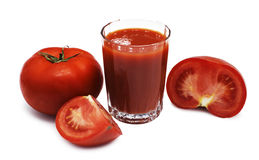 Juice and tomatoes Stock Photos