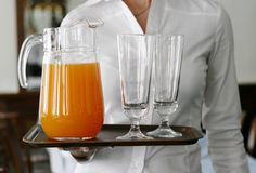 Juice on the tray Stock Images